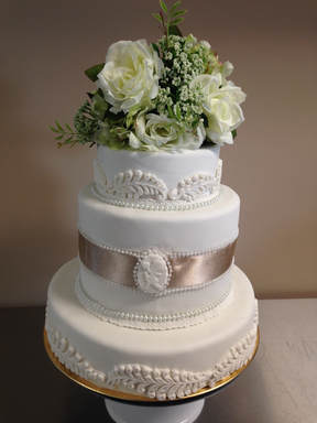 Beautiful 3 Teir Fondant Cake Done In White With Lace Beading And Ribbon Shown Here Silk Flowers